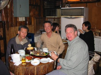Larry and two complete strangers having a wonderful Korean dinner