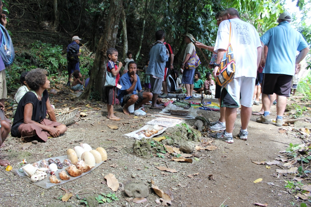 Selling their wares outside one of the skull caves.